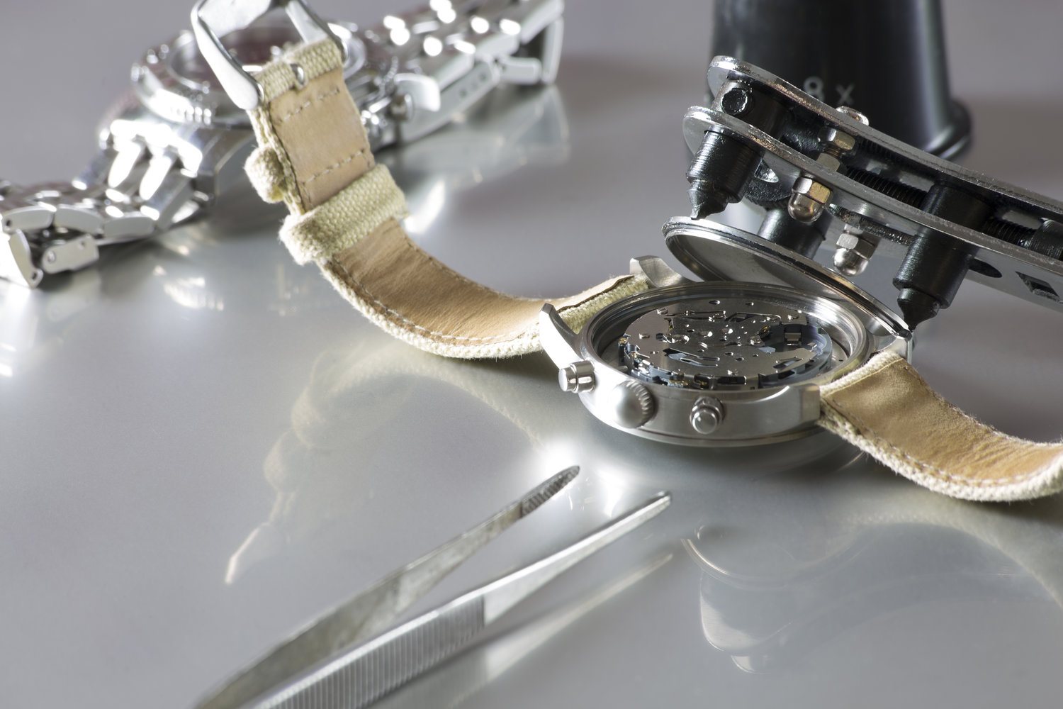 watch battery replacement / macro of replacing a watch battery with watchmaker tools